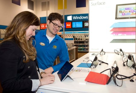 Customer with Blue Shirt at Surface table